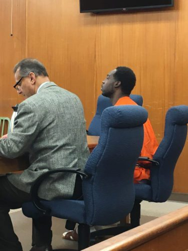 Photo by Jessica Broverman Murder suspect Jordan Davis III, right, appears Thursday for his arraignment in Ohio County Circuit Court. With him is his attorney, Mark Panepinto.
