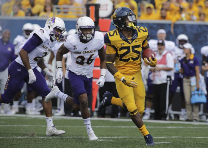 West Virginia running back Justin Crawford (25) runs for a touchdown during the first half of an NCAA college football game against East Carolina, Saturday, Sept. 9, 2017, in Morgantown, W.Va. West Virginia defeated East Carolina 56-20. (AP Photo/Raymond Thompson)