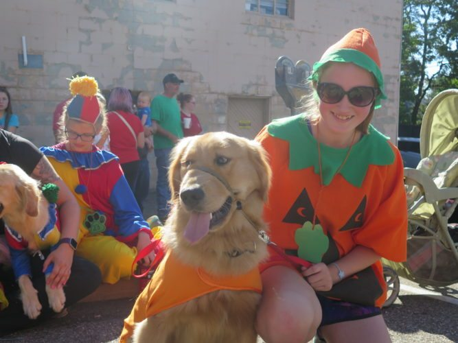 Photo by Alec Berry Mallory Leazendy and her dog Duke pose for a photo at the Barnesville Pumpkin Festival.