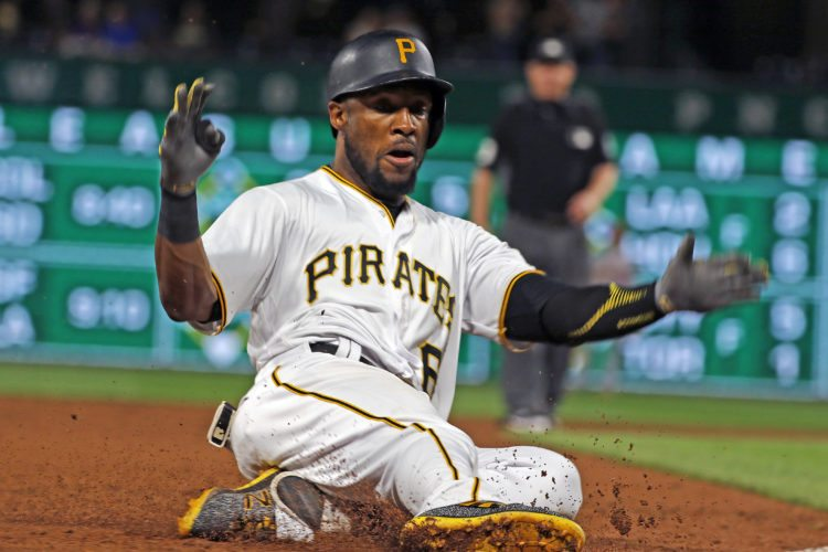 Pittsburgh Pirates' Starling Marte slides safely into third with a triple off St. Louis Cardinals relief pitcher Josh Lucas in the first inning of a baseball game, Saturday, Sept. 23, 2017 in Pittsburgh. (AP Photo/Gene J. Puskar)