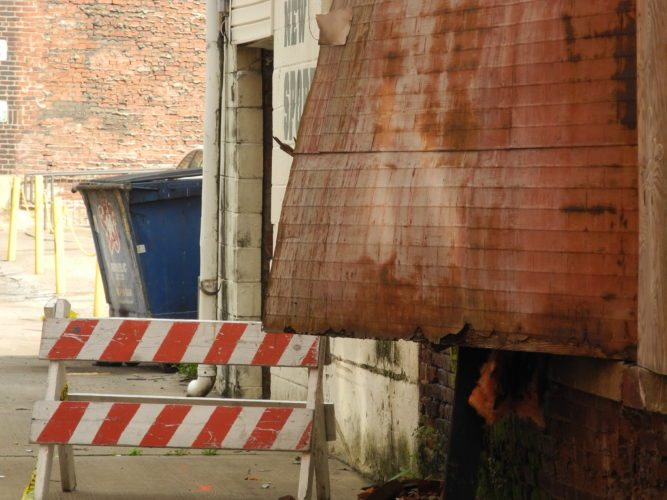 Photo by Casey Junkins Nearly four months after bricks fell from the rear of the city-owned structure at 1429 Market St., Wheeling officials are still waiting to demolish this portion of the building.