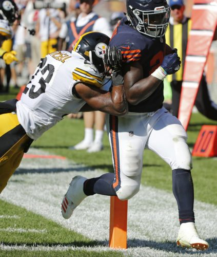 Chicago Bears running back Jordan Howard (24) runs to the end zone for a touchdown past against Pittsburgh Steelers safety Mike Mitchell (23) in overtime of an NFL football game, Sunday, Sept. 24, 2017, in Chicago. The Bears won 23-17 in overtime. (AP Photo/Charles Rex Arbogast)