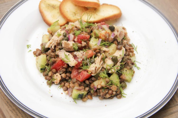 Lentil and salmon salad is from a recipe by Melissa d'Arabian. (Melissa d'Arabian via AP)