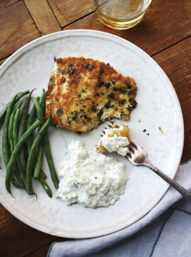 This December 2016 photo shows panko-crusted fish with tzatziki in New York. Tzatziki is one of the most classic Greek sauces, served with everything from pita (as a dip) to lamb to seafood. It's a refreshing mix of cucumber, garlic and yogurt. (Laura Agra via AP)