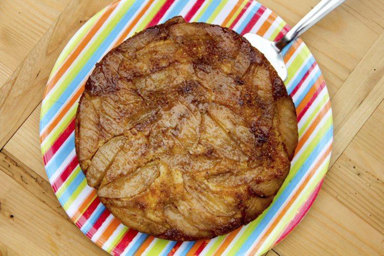 This June 24, 2017 photo shows an apple upside down cornbread in Coronado, Calif. This dish is from a recipe by Melissa d'Arabian. (Melissa d'Arabian via AP)