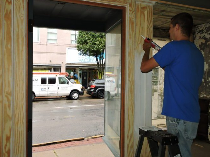 Photo by Casey Junkins Gary Lingaman of BK Construction works to renovate the inside of the former Bill's Hamburger building at the corner of 10th and Main streets in downtown Wheeling. Soon, the structure will be home to J. Jones Evening Wear.