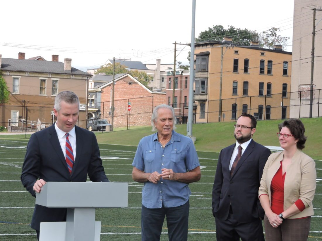 Photo by Heather Ziegler Wheeling Mayor Glenn Elliott, at podium, announces funding for bleachers at the J.B. Chambers Memorial Recreation Park in East Wheeling. Looking on, from left, are donor Gary West, Vice Mayor Chad Thalman and Councilwoman Wendy Scatterday.