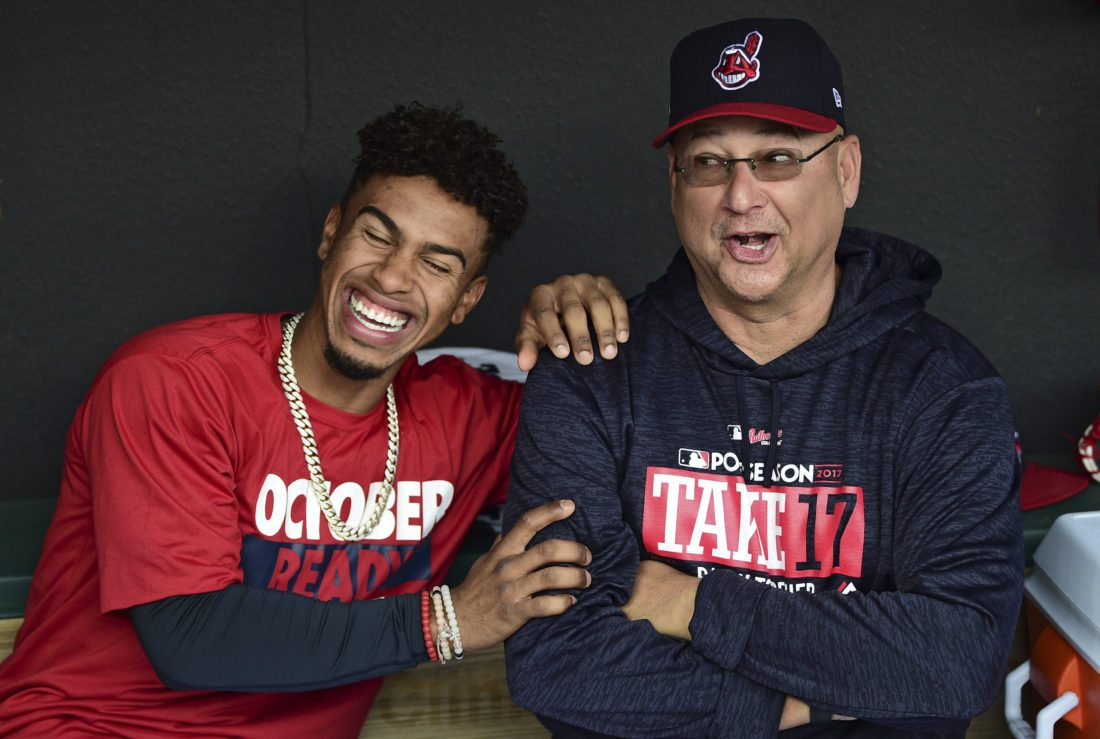 Cleveland Indians' Francisco Lindor, left, and manager Terry Francona share a laugh during a baseball workout, Tuesday, Oct. 10, 2017, in Cleveland. The Indians host the New York Yankees on Wednesday in Game 5 of the ALDS. (AP Photo/David Dermer)