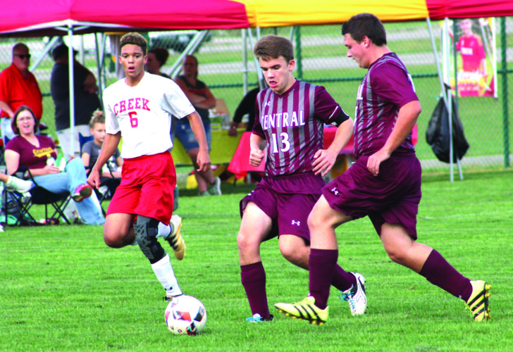 Photo by Joe Catullo Wheeling Central's Daniel O'Leary (13) and Alex Magruder battle for possession with Indian Creek's Malik Archie during Tuesday's game in Mingo Junction.