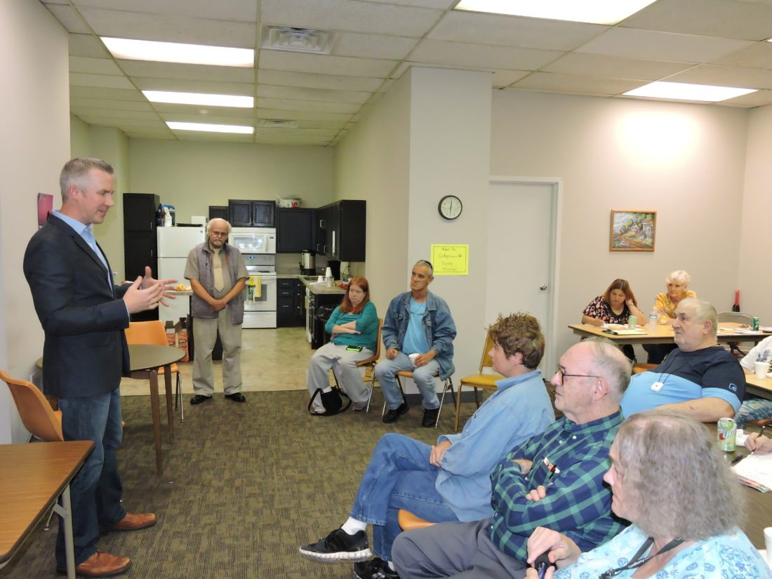 Photo by Casey Junkins Wheeling Mayor Glenn Elliott speaks Wednesday with residents of the Windsor Manor apartment building.