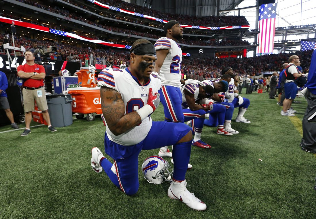 Some Buffalo Bills players take a knee during the national anthem before the first half of an NFL football game between the Atlanta Falcons and the Buffalo Bills, Sunday, Oct. 1, 2017, in Atlanta. (AP Photo/John Bazemore)
