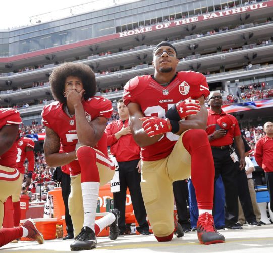 FILE - In this Oct. 2, 2016 file photo, San Francisco quarterback Colin Kaepernick, left, and safety Eric Reid kneel during the national anthem before an NFL football game against the Dallas Cowboys in Santa Clara, Calif.  The 49ers won't be forcing their players to stand during the national anthem, safety Eric Reid said Wednesday, Oct. 11, 2017. Reid, the first player to join Colin Kaepernick in protest last season, said he had a conversation recently with 49(AP Photo/Marcio Jose Sanchez, File)