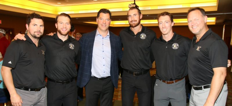 Photos by Joe Lovell Members of the Wheeling Nailers pose with Pittsburgh Penguins assistant general manager and Wilkes-Barre/Scranton Penguins general manager Bill Guerin, center. From left are, Riley Armstrong, Derek Army, Guerin, Nick Sorkin, Danny Fick and Nailers coach Jeff Christian.