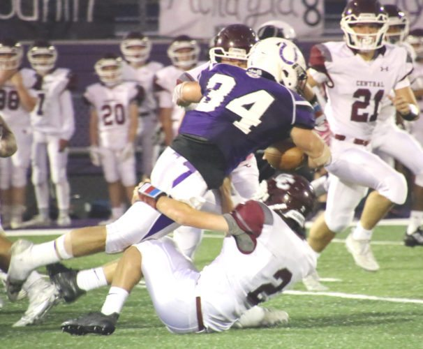 Martins Ferry's  Dalton Hoover (34) runs over Wheeling Central's Pat Brown during  Friday's game at the Dave Bruney Football Complex. Photo by  Joe Lovell Martins Ferry's  Dalton Hoover (34) runs over Wheeling Central's Pat Brown during  Friday's game at the Dave Bruney Football Complex.