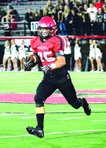 Photo by Michael D. McElwain Steubenville's Jacob Bernard looks for running room during Friday night's game against New Philadelphia.