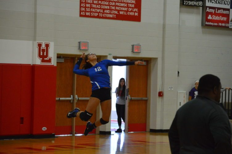 East  Liverpool's Skye Stokes jumps  during a serve in  Saturday's OVAC 4A title match with Oak Glen at Union Local.   Photo by  Cody Tomer