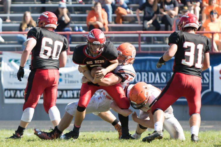 Photo by Sherri McAninch Bellaire quarterback Mason Ramsay is brought down by Shadyside's Alex Krupa during Saturday's game at Nelson Field.