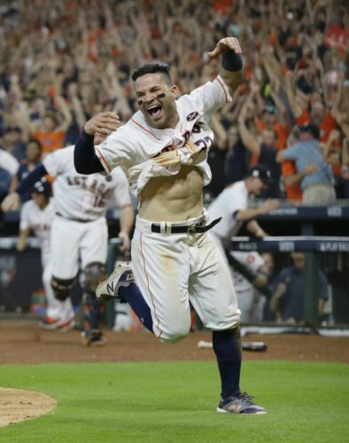 Houston Astros' Jose Altuve reacts after scoring the game-winning run during the ninth inning of Game 2 of baseball's American League Championship Series against the New York Yankees Saturday, Oct. 14, 2017, in Houston. The Astros won 2-1 to take a 2-0 lead in the series. (AP Photo/Tony Gutierrez)