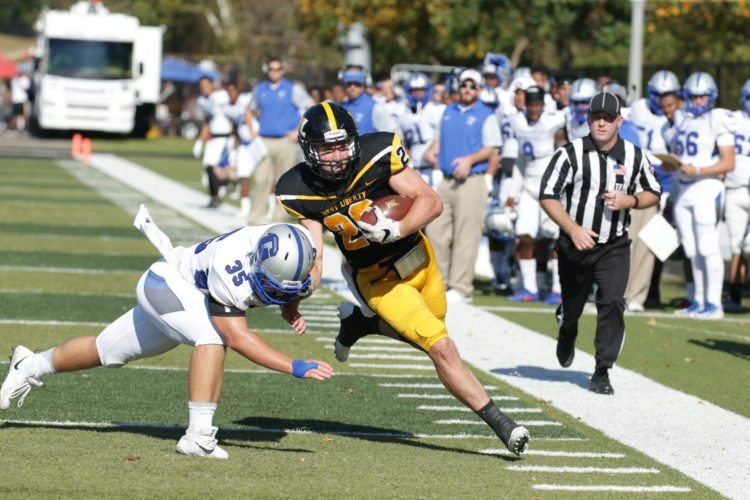 Photo by Alex Kozlowski West Liberty's Ian Kelly (22) runs down the sideline as Glenville State linebacker Wil Mayes tries to force him out of bounds.