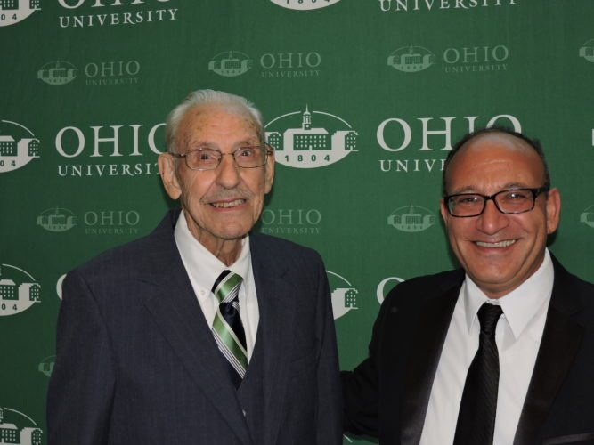 Photo by Heather Ziegler Celebrating Ohio University Eastern's 60th anniversary at the university gala Saturday night at River City Restaurant in Wheeling are the first dean of the school, Robert Bovenizer, left, and current campus dean Paul Abraham, Ph.D.
