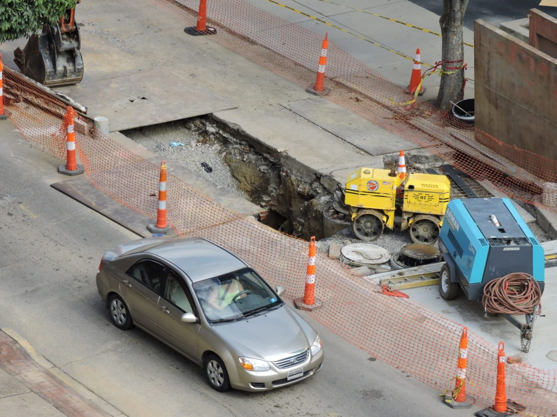 Photos by Casey Junkins A hole in Main Street in downtown Wheeling marks the spot contractors are continuing to work on the $755,000 sewer separation system.