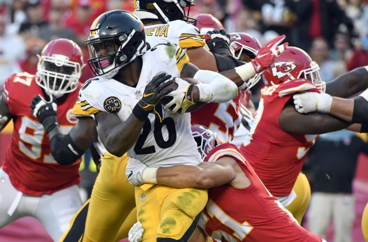 Pittsburgh Steelers running back Le'Veon Bell (26) is tackled by Kansas City Chiefs linebacker Frank Zombo (51) during the second half of an NFL football game in Kansas City, Mo., Sunday, Oct. 15, 2017. (AP Photo/Ed Zurga)
