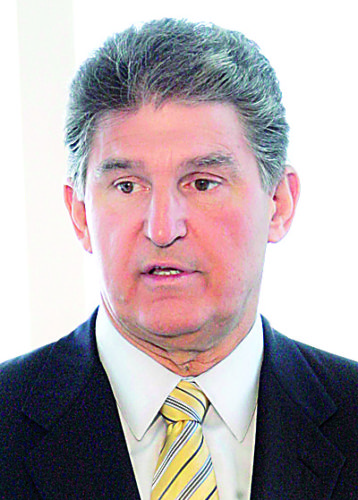 National Governors Association vice chairman Vermont Gov. Jim Douglas, listens as West Virginia's Democratic Gov. Joe Manchin, left, speaks during a news conference before the opening of the annual NGA meeting in Gulfport, Miss., Saturday, July 18, 2009. Manchin noted much of the funds were directed to Medicaid and education.  (AP Photo/Rogelio V. Solis)