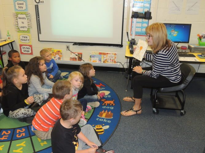 """Photo by Drew Parker  Center McMechen Elementary School students participate in Jumpstart's """"Read for the Record"""" program on Monday."""