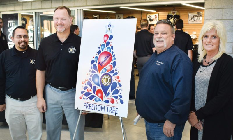 Photo by Scott McCloskey  Posing for a photo after Tuesday's announcement of the Freedom Tree Initiative between Thomas Auto Centers of St. Clairsville and the Wheeling Nailers, from left, are Nailers Director of Media and Community Relations D.J. Abisalih, Nailers head coach Jeff Christian and Robert Thomas, vice president of Thomas Auto Centers of St. Clairsville, and his wife, Robin Thomas.