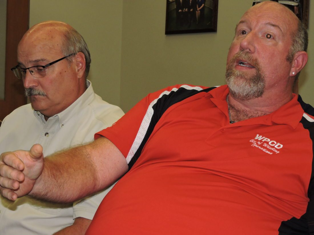 Photo by Casey Junkins Wheeling Water Pollution Control Operations Supervisor Brock Castilow, right, and Public Works Director Russell Jebbia look on during a Tuesday information session.