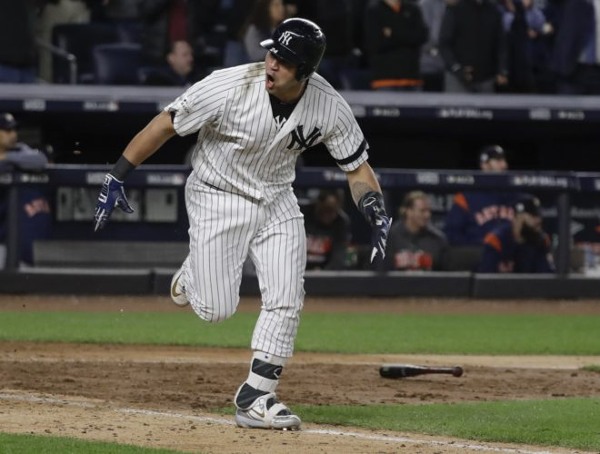 New York Yankees' Gary Sanchez reacts after hitting a two-run scoring double during the eighth inning of Game 4 of baseball's American League Championship Series against the Houston Astros Tuesday, Oct. 17, 2017, in New York. (AP Photo/David J. Phillip)