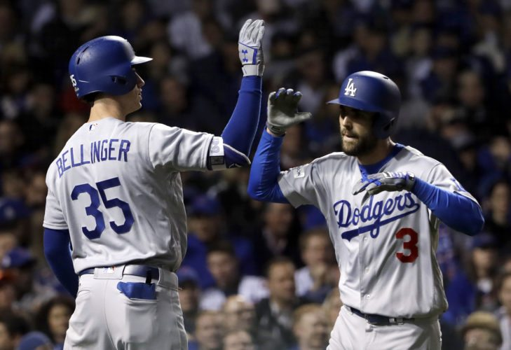 Los Angeles Dodgers' Chris Taylor (3) celebrates his home run with Cody Bellinger (35) during the third inning of Game 3 of baseball's National League Championship Series against the Chicago Cubs, Tuesday, Oct. 17, 2017, in Chicago. (AP Photo/Matt Slocum)