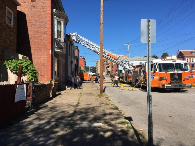 Emergency crews respond to a fire in the 2300 block of Eoff Street in Wheeling Wednesday afternoon.