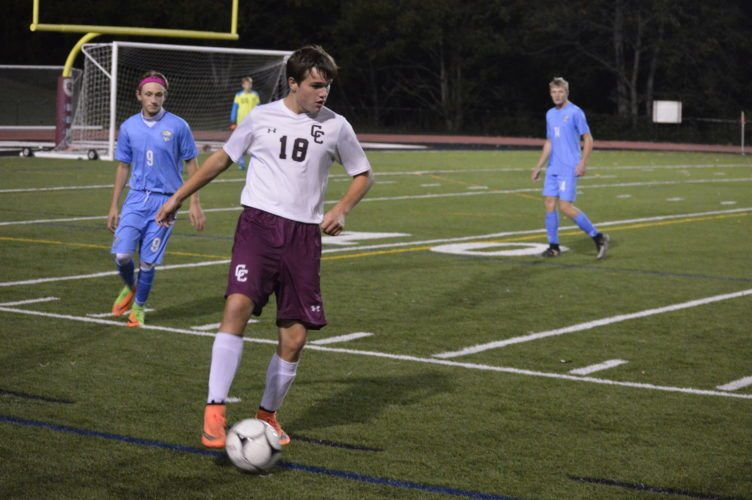 Photo by Cody Tomer Wheeling Central's Jerod Buck controls the ball with Oak Glen's Coleman Conley (9) looking on during Wednesday's sectional match at WJU.