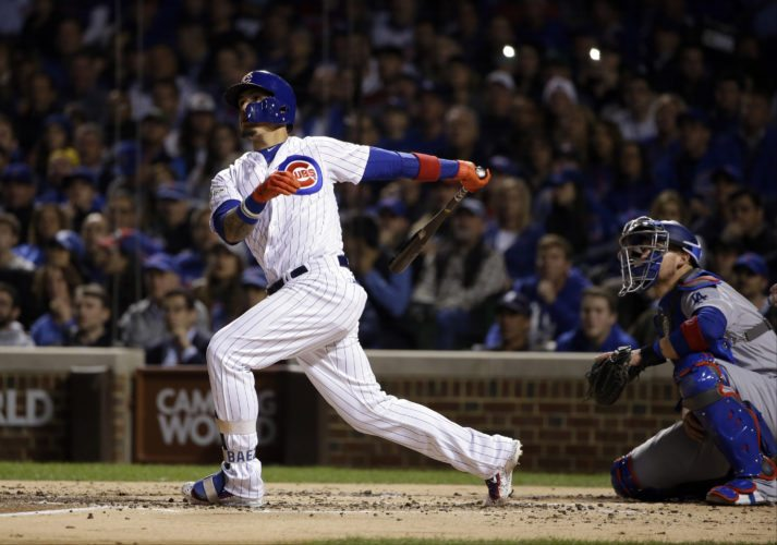 Chicago Cubs' Javier Baez watches his home run during the second inning of Game 4 of baseball's National League Championship Series against the Los Angeles Dodgers, Wednesday, Oct. 18, 2017, in Chicago. (AP Photo/Nam Y. Huh)