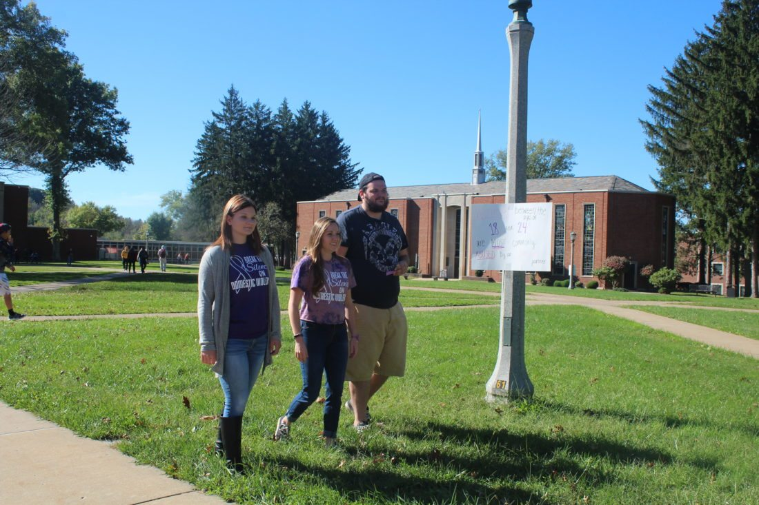 Photos Provided From left, Lindsay Dowdle, Meredith Garner and Billy Campbell take part in the walk to raise awareness on domestic violence Wednesday at West Liberty University.