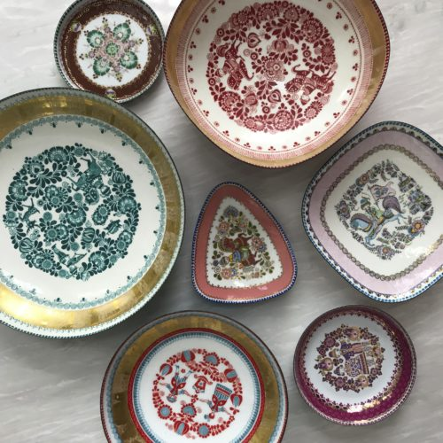 This undated photo provided by Jenny Dina Kirschner shows vintage plates. Interior designer Kirschner discovered one of these vintage Steinbock Enamel candy dishes at a flea market, then searched online for other pieces in the same series. (Jenny Dina Kirschner via AP)
