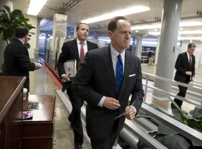 Sen. Pat Toomey, R-Pa., a member of the Senate Budget Committee, heads to the floor during a series of votes at the Capitol in Washington, Thursday, Oct. 19, 2017. (AP Photo/J. Scott Applewhite)