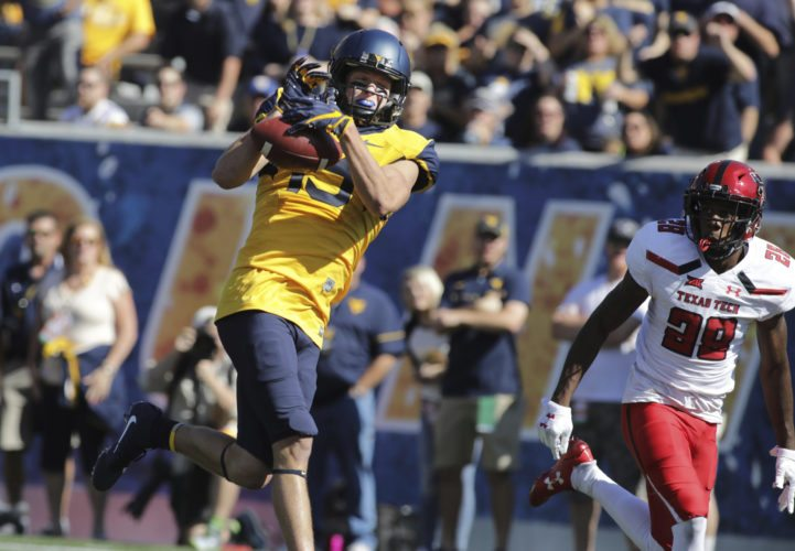 File-This Oct. 14, 2017, file photo shows West Virginia wide receiver David Sills (13) during an NCAA college football game, in Morgantown, W.Va. (AP Photo/Raymond Thompson, File)