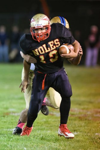 Photo by Katie Parks Monroe Central's Omar Plato tries to fight off a Frontier defender Friday in Woodsfield.