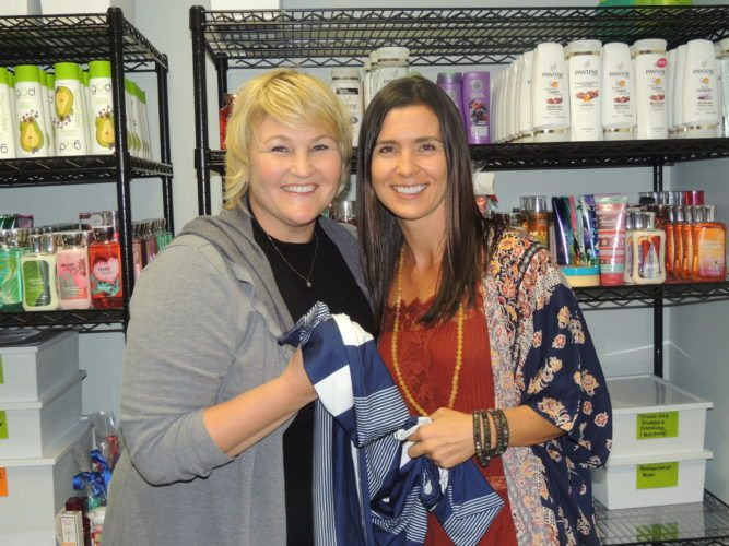 Photo by Drew Parker  Greta Zukoff, right,      owner of              AMAROO Baby, plans a by-sale donation program with           Marshall County Family Resource Network executive director          Stacie Dei.