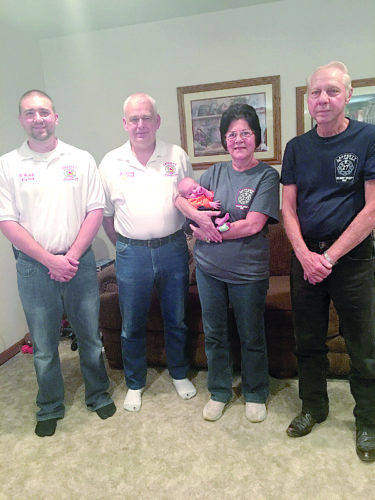 Photo Provided  Posing with newborn Katie Kildow, who was delivered inside her Belmont home, are, from left, Lafferty VFD Assistant Fire Chief Dustin Hudak, Fire Chief Larry Zalesny, EMT Diane Hudak and e-squad driver Jim Garrett with baby Katie.