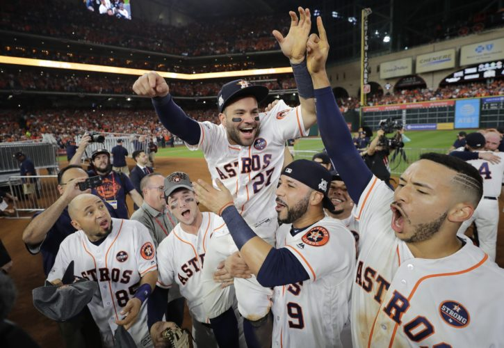 Houston Astros' Jose Altuve is lifted by teammates after Game 7 of baseball's American League Championship Series against the New York Yankees Saturday, Oct. 21, 2017, in Houston. The Astros won 4-0 to win the series. (AP Photo/David J. Phillip)