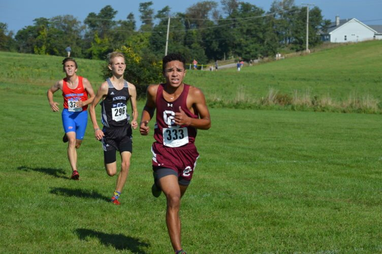Photo by Cody Tomer Quintin Thomas, front, will represent WheelingCentral as he runs in the West Virginia state cross country meet in Ona on Saturday.