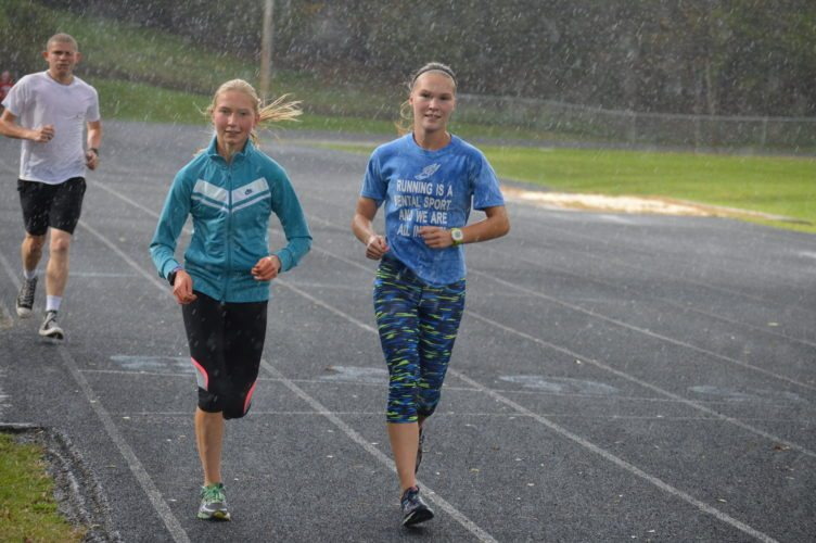 Photo by Cody Tomer Wheeling Park's Isabella DiSaia, left, and Beighley Ayers are both projected in the top 10 of the state cross country meet on Saturday at Cabell Midland.