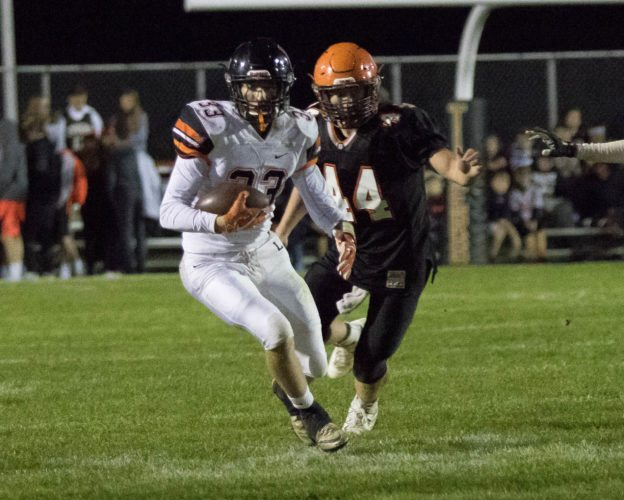 Sheri McAninch Linsly's Joe Zaccirey (33) breaks into the open field as he is pursued by Shadyside's Connor Banco during their game Friday night at Fleming Field.