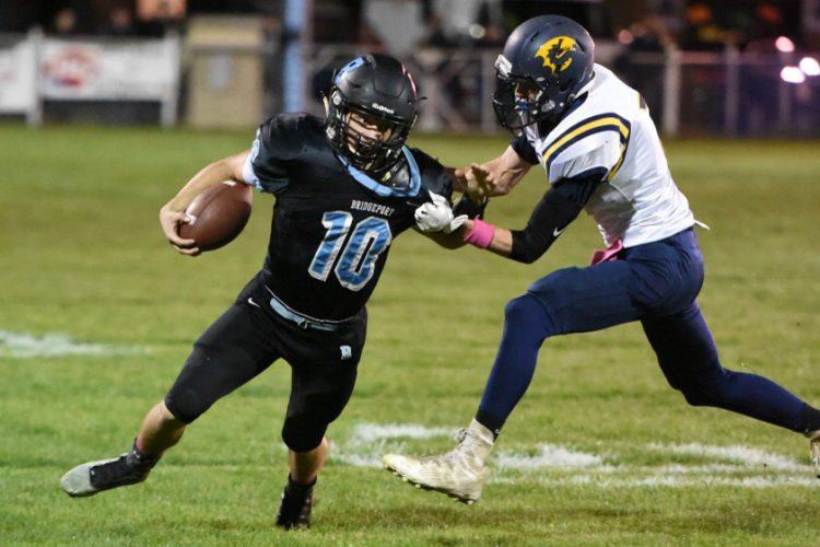 Photo by Caleb Nelson Bridgeport quarterback Tino Kusic (10)is brought down by Cameron defender Travis Mickey in Brookside.