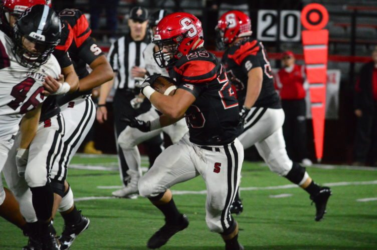 Photo by Michael D. McElwain Steubenville's Jacob Bernard (25)looks for a blocker as he takes off during Friday night's 30-0 victory against University School.