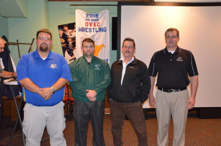 Photo by Kim North The Ohio Valley Athletic Conference wrestling community welcomed seven new coaches during a press conference Monday night inside WesBanco Arena. They are, from left, Jimmy Malone (Southern Local), Michael Owens (Paden City), Scott Hiemstra (East Liverpool) and Jimmy Benson (Edison). Not pictured are Jamie Lesho (Madonna), Derrick Hesson (Caldwell) and Vic Nery (Crestview).