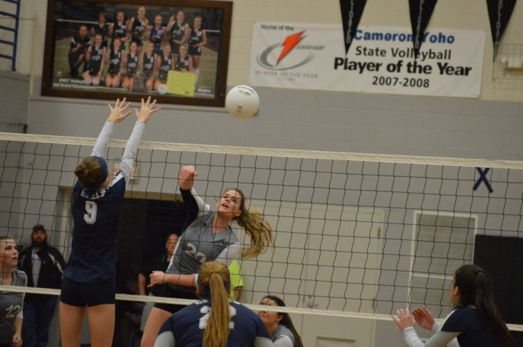 Tyler  Consolidated's Alexa Johnson delivers a kill during the regional title home game last weekend against Ritchie County.  Photo by  Cody Tomer